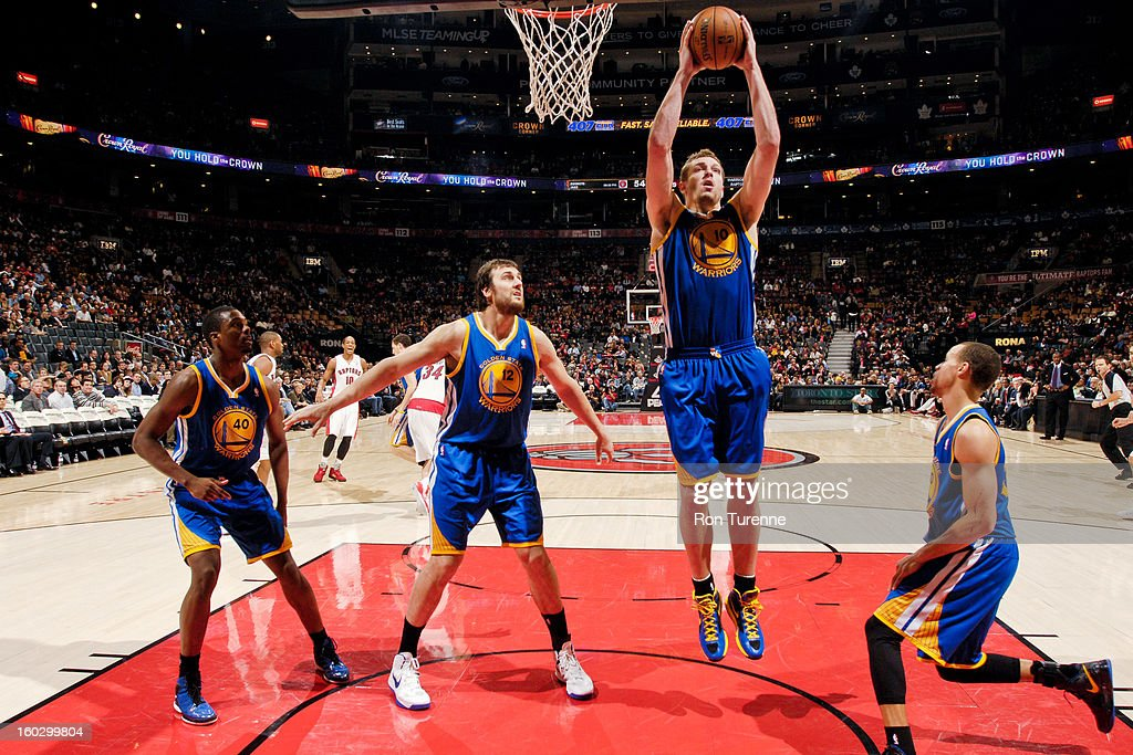 David Lee #10 of the Golden State Warriors grabs a rebound against the Toronto Raptors on January 28, 2013 at the Air Canada Centre in Toronto, Ontario, Canada.