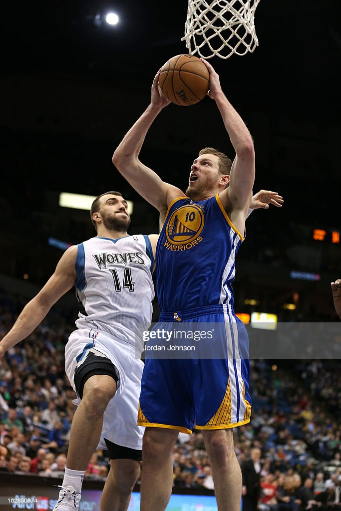 David Lee #10 of the Golden State Warriors grabs a rebound against the Minnesota Timberwolves on February 24, 2013 at Target Center in Minneapolis, Minnesota.
