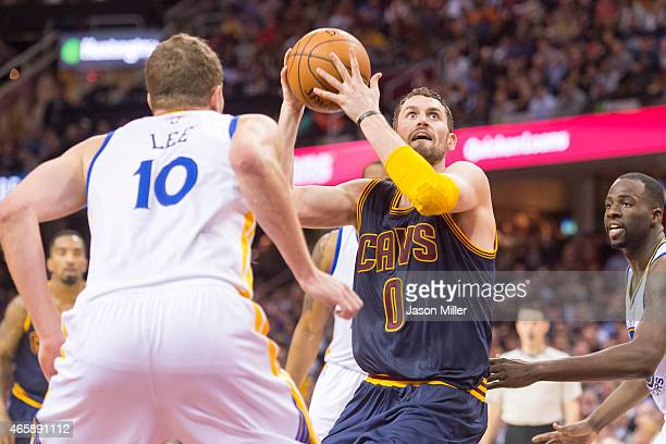 David Lee of the Golden State Warriors guards Kevin Love of the Cleveland Cavaliers during the second half at Quicken Loans Arena on February 26 2015...