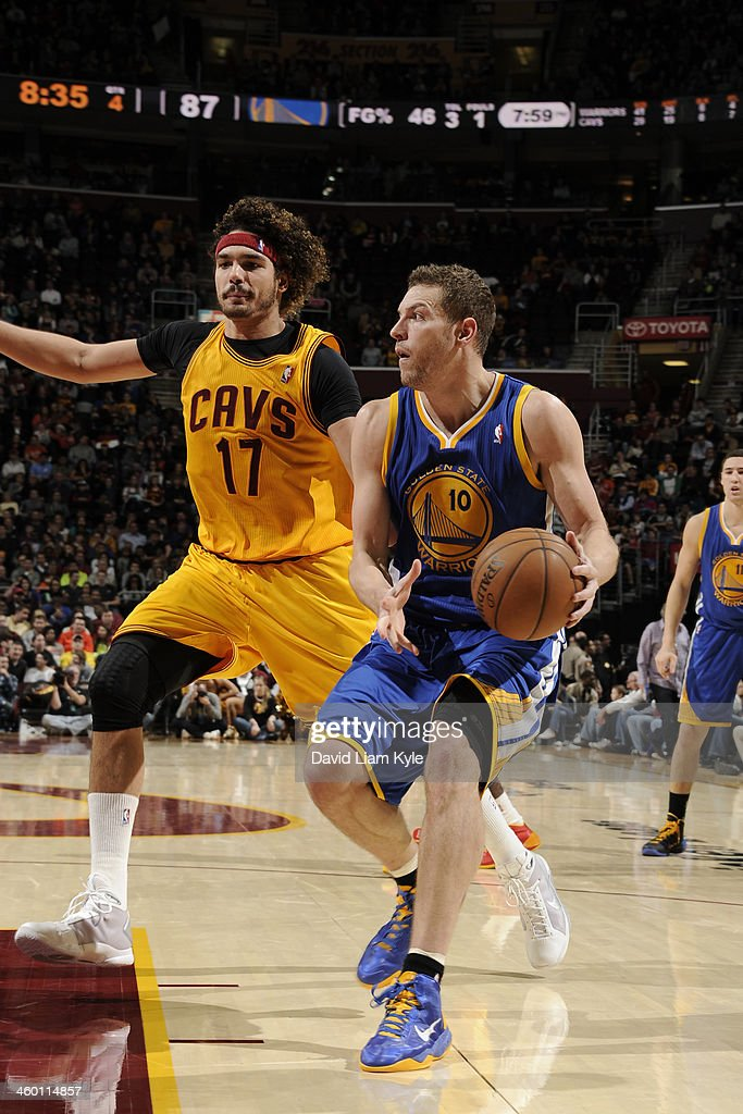 David Lee #10 of the Golden State Warriors handles the ball against <a gi-track='captionPersonalityLinkClicked' href=/galleries/search?phrase=Anderson+Varejao&family=editorial&specificpeople=202247 ng-click='$event.stopPropagation()'>Anderson Varejao</a> #17 of the Cleveland Cavaliers at The Quicken Loans Arena on December 29, 2013 in Cleveland, Ohio.