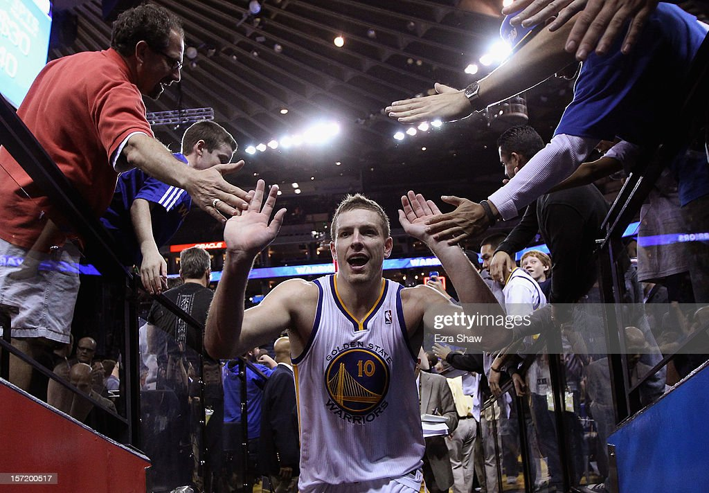 David Lee #10 of the Golden State Warriors is congratulated by fans as he heads back to the lockerroom after they beat the Denver Nuggets at Oracle Arena on November 29, 2012 in Oakland, California.