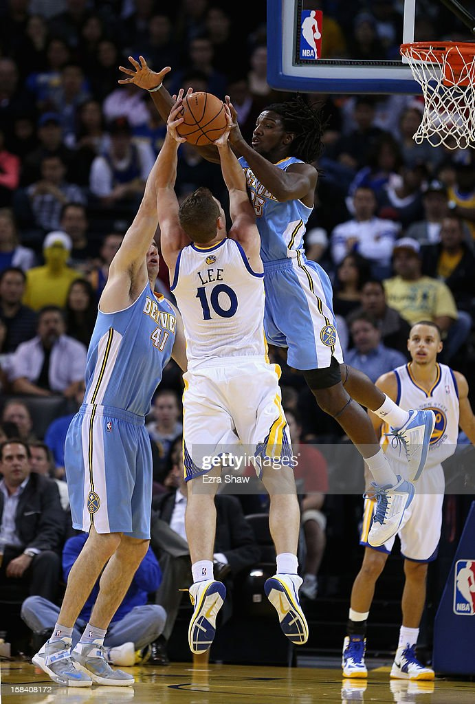 David Lee #10 of the Golden State Warriors is defended by <a gi-track='captionPersonalityLinkClicked' href=/galleries/search?phrase=Kosta+Koufos&family=editorial&specificpeople=4216032 ng-click='$event.stopPropagation()'>Kosta Koufos</a> #41 and <a gi-track='captionPersonalityLinkClicked' href=/galleries/search?phrase=Kenneth+Faried&family=editorial&specificpeople=5765135 ng-click='$event.stopPropagation()'>Kenneth Faried</a> #35 of the Denver Nuggets at Oracle Arena on November 29, 2012 in Oakland, California.