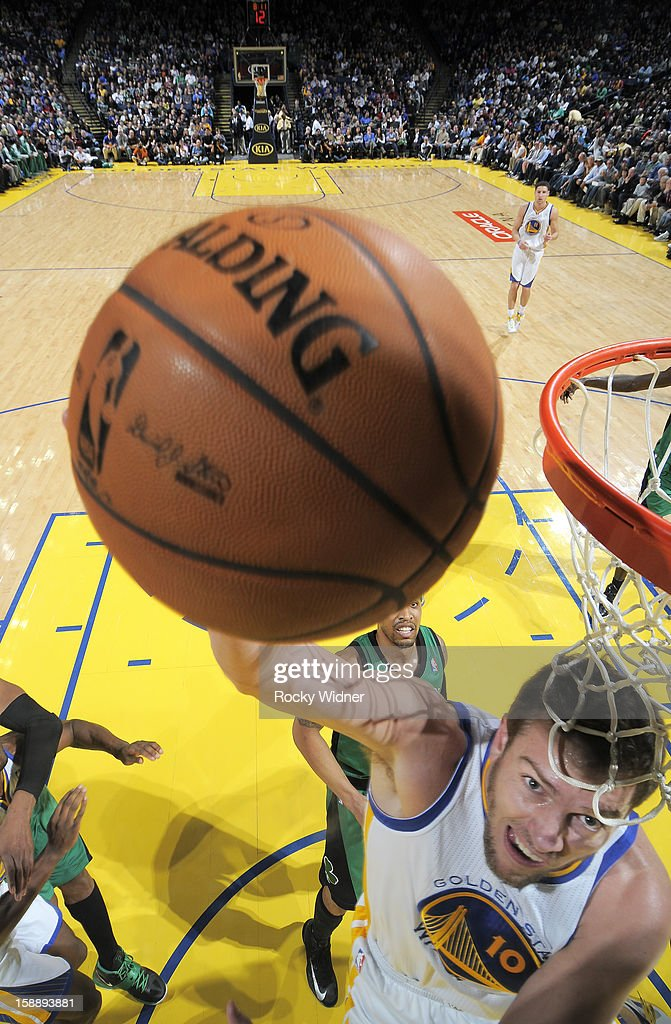 David Lee #10 of the Golden State Warriors lays the ball up against the Boston Celtics on December 29, 2012 at Oracle Arena in Oakland, California.