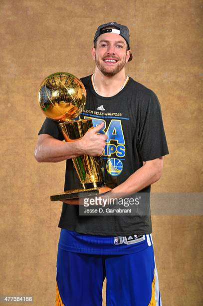 David Lee of the Golden State Warriors poses for a portrait with the Larry O'Brien trophy after defeating the Cleveland Cavaliers in Game Six of the...