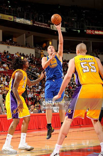 David Lee of the Golden State Warriors puts up the shot against Jordan Hill and Greg Somogyi of the Los Angeles Lakers during a preseason game at the...