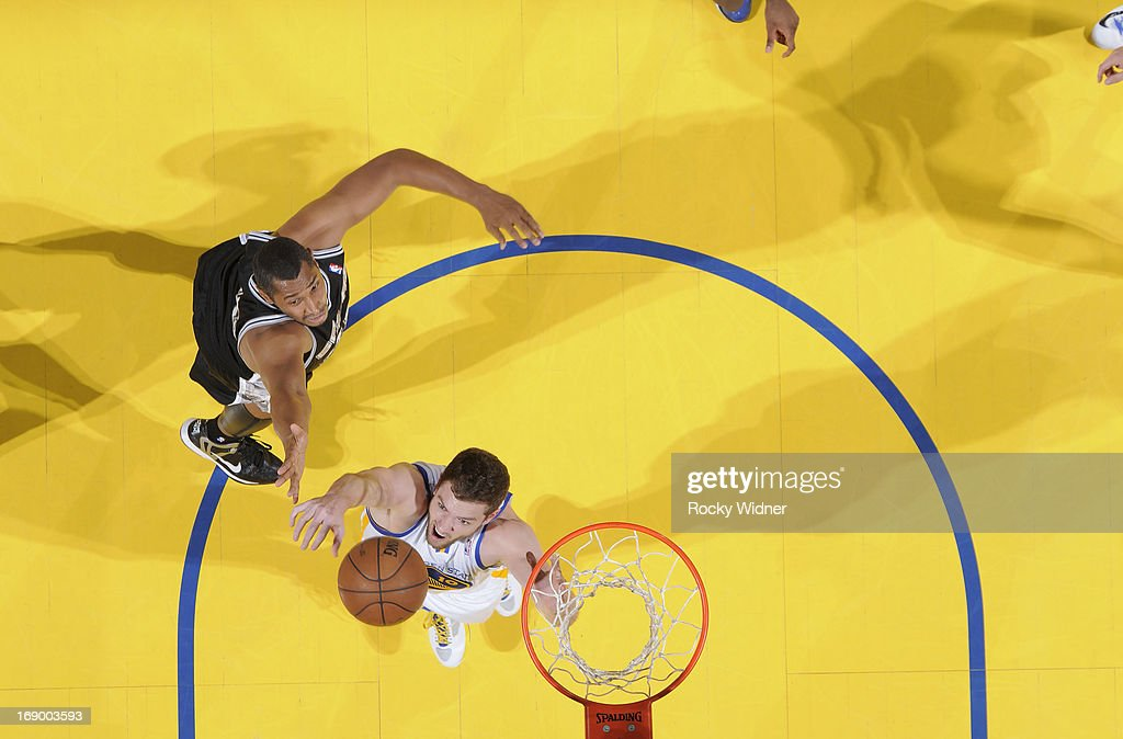 David Lee #10 of the Golden State Warriors rebounds against <a gi-track='captionPersonalityLinkClicked' href=/galleries/search?phrase=Boris+Diaw&family=editorial&specificpeople=201505 ng-click='$event.stopPropagation()'>Boris Diaw</a> #33 of the San Antonio Spurs in Game Four of the Western Conference Semifinals during the 2013 NBA Playoffs on May 12, 2013 at Oracle Arena in Oakland, California.