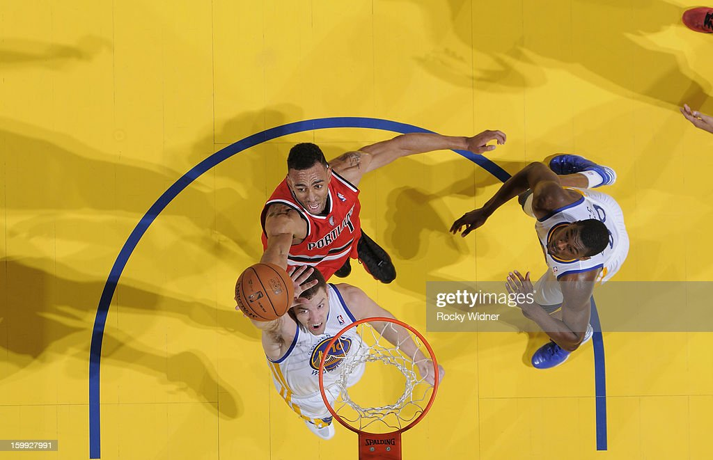 David Lee #10 of the Golden State Warriors rebounds against <a gi-track='captionPersonalityLinkClicked' href=/galleries/search?phrase=Jared+Jeffries&family=editorial&specificpeople=202548 ng-click='$event.stopPropagation()'>Jared Jeffries</a> #1 of the Portland Trail Blazers on January 11, 2013 at Oracle Arena in Oakland, California.