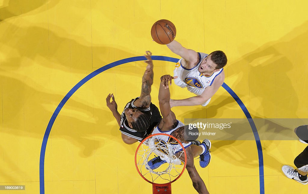 David Lee #10 of the Golden State Warriors rebounds against <a gi-track='captionPersonalityLinkClicked' href=/galleries/search?phrase=Kawhi+Leonard&family=editorial&specificpeople=6691012 ng-click='$event.stopPropagation()'>Kawhi Leonard</a> #2 of the San Antonio Spurs in Game Four of the Western Conference Semifinals during the 2013 NBA Playoffs on May 12, 2013 at Oracle Arena in Oakland, California.