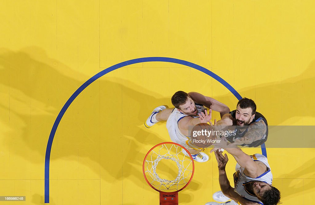 David Lee #10 of the Golden State Warriors rebounds against <a gi-track='captionPersonalityLinkClicked' href=/galleries/search?phrase=Nikola+Pekovic&family=editorial&specificpeople=829137 ng-click='$event.stopPropagation()'>Nikola Pekovic</a> #14 of the Minnesota Timberwolves on April 9, 2013 at Oracle Arena in Oakland, California.
