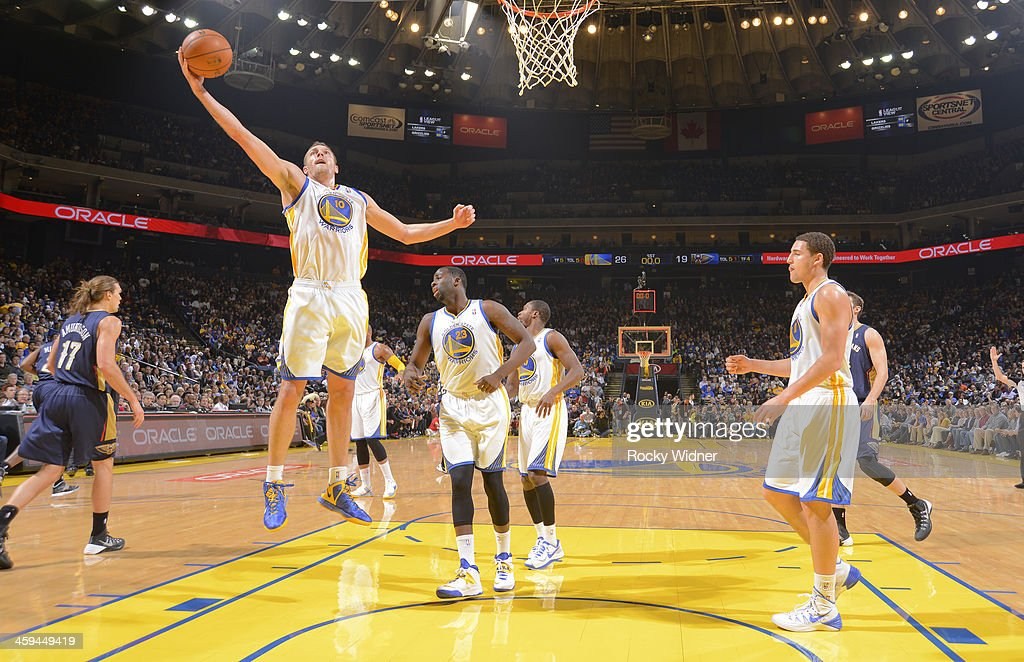 David Lee #10 of the Golden State Warriors rebounds against the New Orleans Pelicans on December 17, 2013 at Oracle Arena in Oakland, California.
