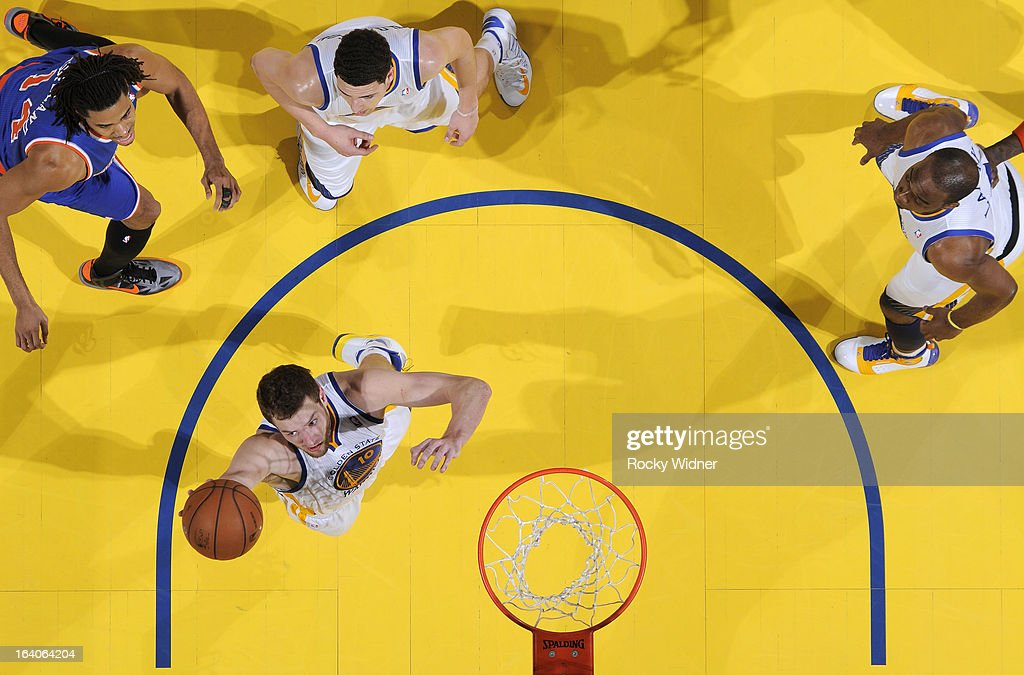 David Lee #10 of the Golden State Warriors rebounds against the New York Knicks on March 11, 2013 at Oracle Arena in Oakland, California.