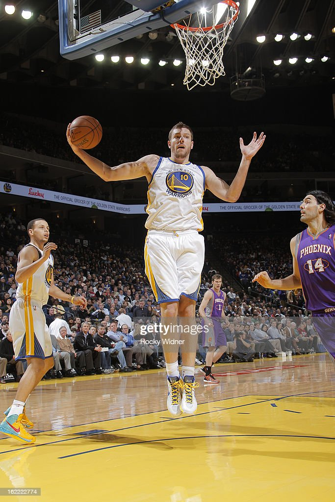 David Lee #10 of the Golden State Warriors rebounds against the Phoenix Suns on February 20, 2013 at Oracle Arena in Oakland, California.