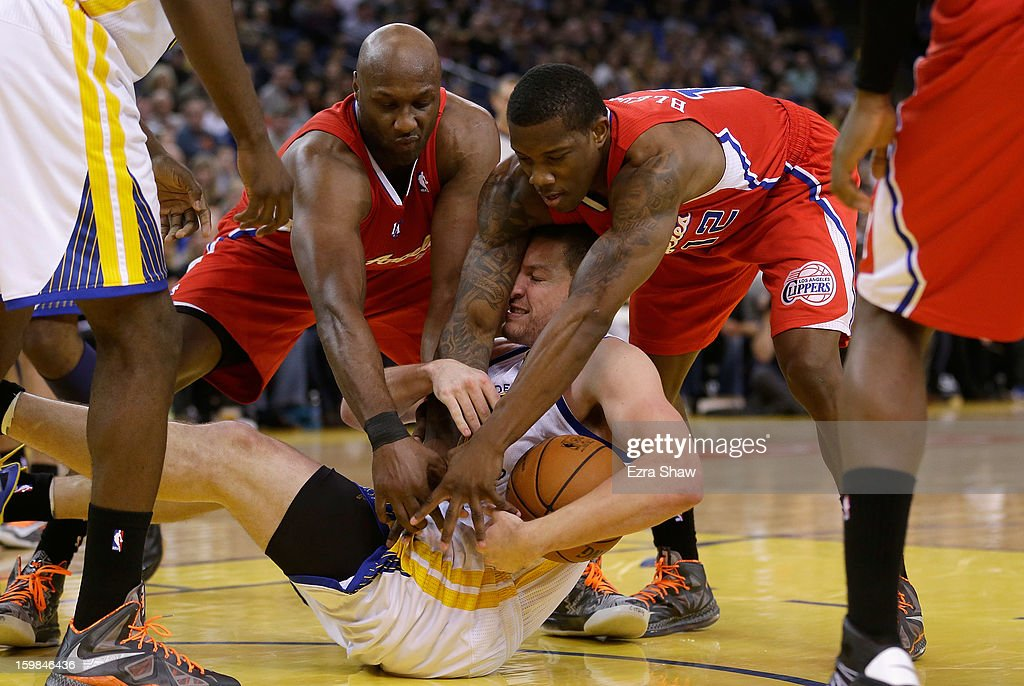 David Lee #10 of the Golden State Warriors scrammbles for a loose ball against Lamar Odom #7 of the Los Angeles Clippers and Eric Bledsoe #12 of the Los Angeles Clippers at Oracle Arena on January 21, 2013 in Oakland, California.