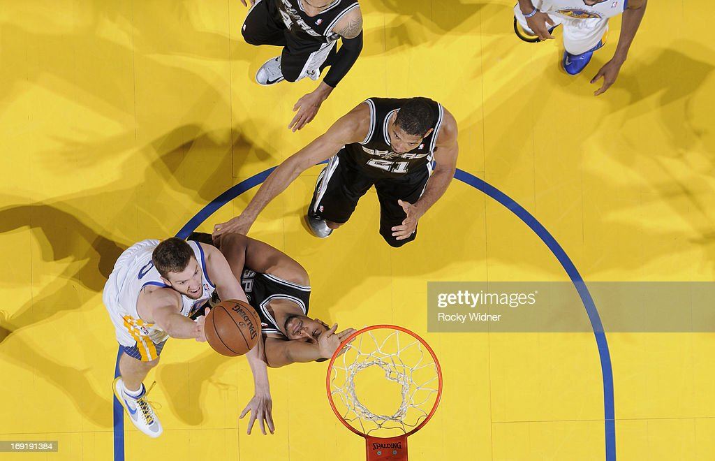David Lee #10 of the Golden State Warriors shoots a layup against Boris Diaw #33 of the San Antonio Spurs in Game Six of the Western Conference Semifinals during the 2013 NBA Playoffs on May 16, 2013 at Oracle Arena in Oakland, California.