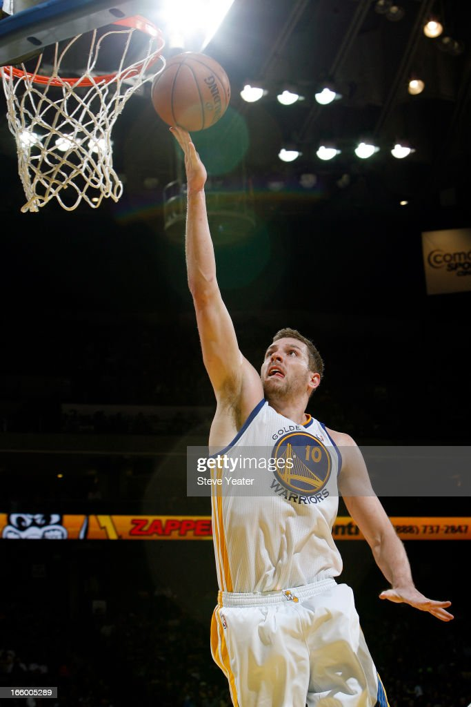 David Lee #10 of the Golden State Warriors shoots a layup against the Utah Jazz on April 7, 2013 at Oracle Arena in Oakland, California.