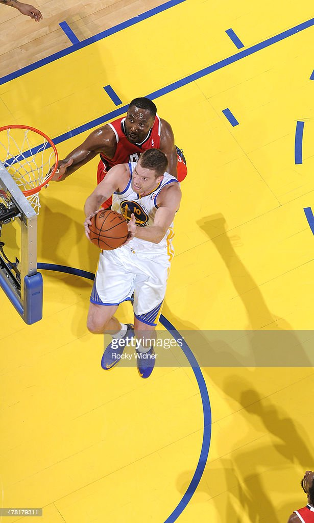 David Lee #10 of the Golden State Warriors shoots a layup against the Atlanta Hawks on March 7, 2014 at Oracle Arena in Oakland, California.