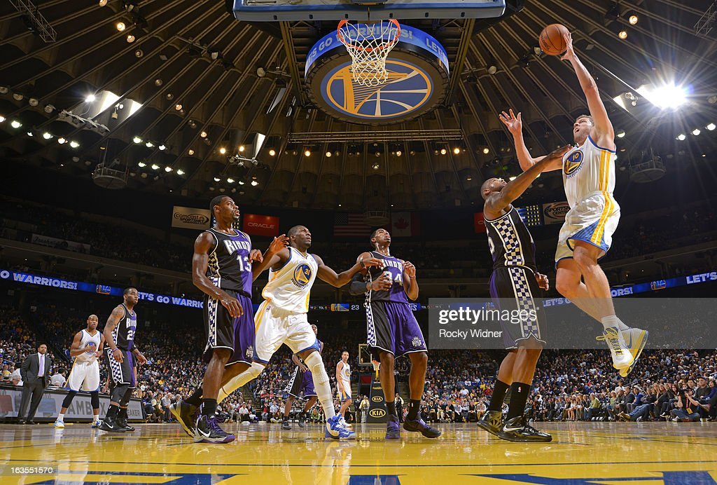 David Lee #10 of the Golden State Warriors shoots against <a gi-track='captionPersonalityLinkClicked' href=/galleries/search?phrase=DeMarcus+Cousins&family=editorial&specificpeople=5792008 ng-click='$event.stopPropagation()'>DeMarcus Cousins</a> #15 of the Sacramento Kings on March 6, 2013 at Oracle Arena in Oakland, California.