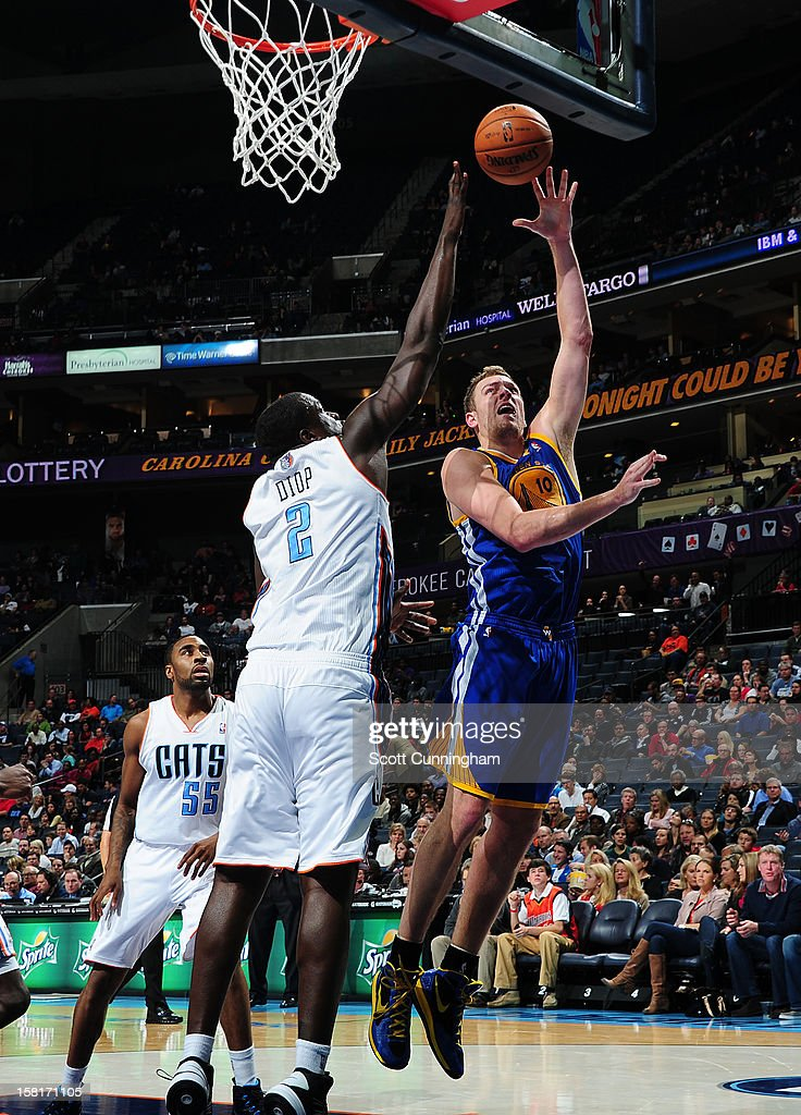 David Lee #10 of the Golden State Warriors shoots against DeSagana Diop #2 of the Charlotte Bobcats at Time Warner Cable Arena on December 10, 2012 in Charlotte, North Carolina.