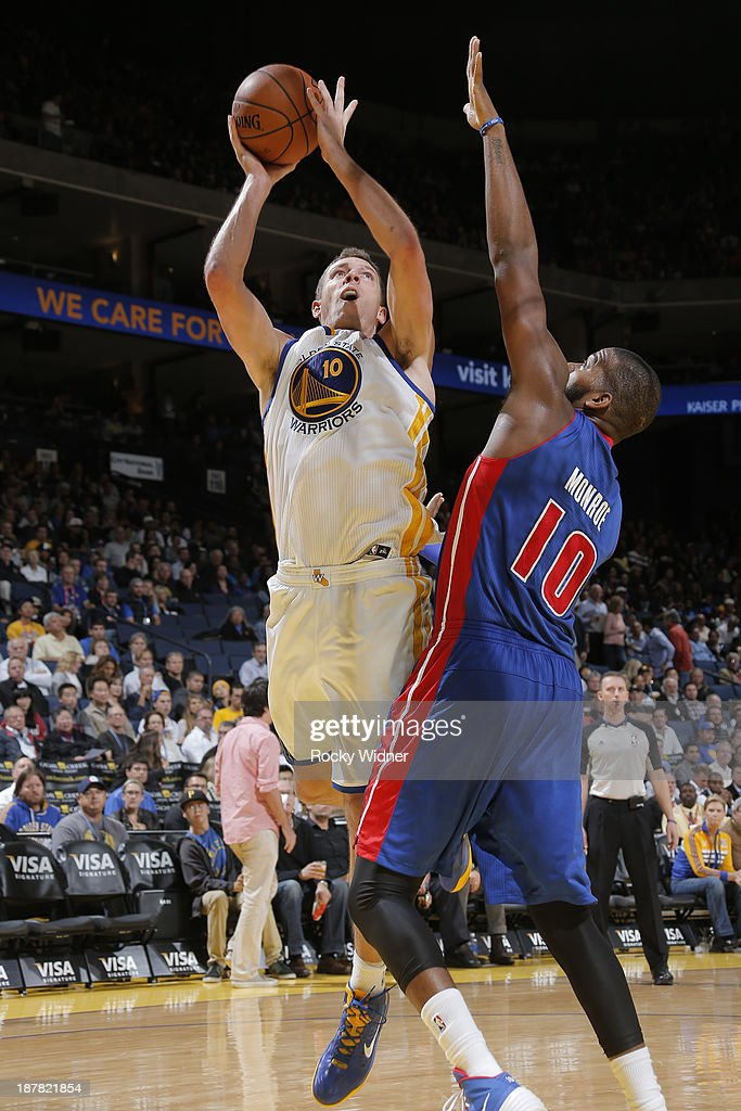 David Lee #10 of the Golden State Warriors shoots against Greg Monroe #10 of the Detroit Pistons on November 12, 2013 at Oracle Arena in Oakland, California.