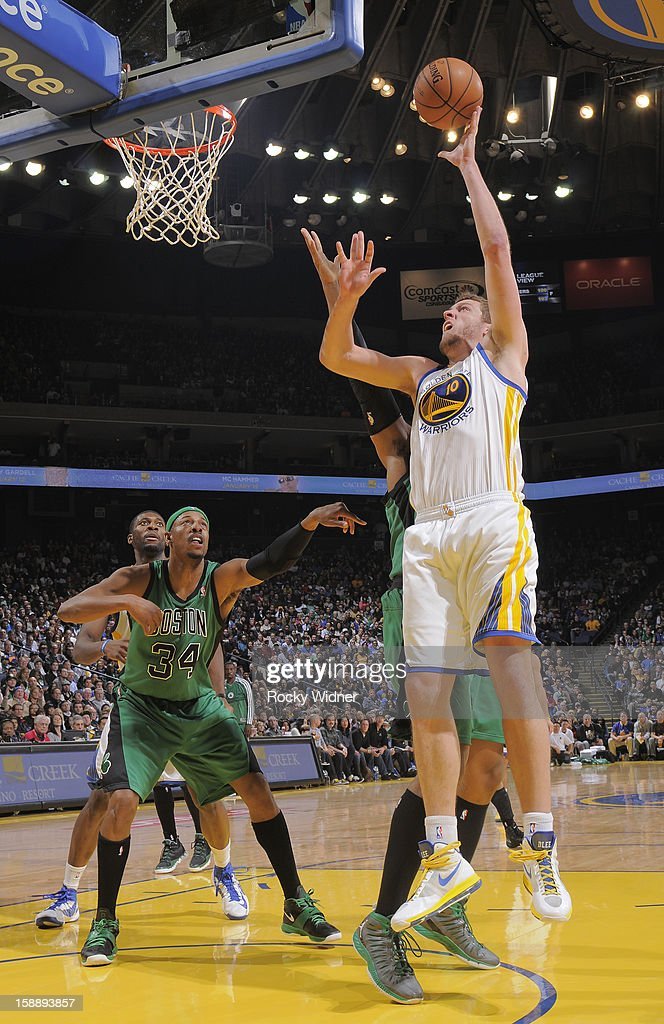 David Lee #10 of the Golden State Warriors shoots against Jared Sullinger #7 of the Boston Celtics on December 29, 2012 at Oracle Arena in Oakland, California.