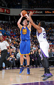 David Lee of the Golden State Warriors shoots against Jason Thompson of the Sacramento Kings on February 3 2015 at Sleep Train Arena in Sacramento...
