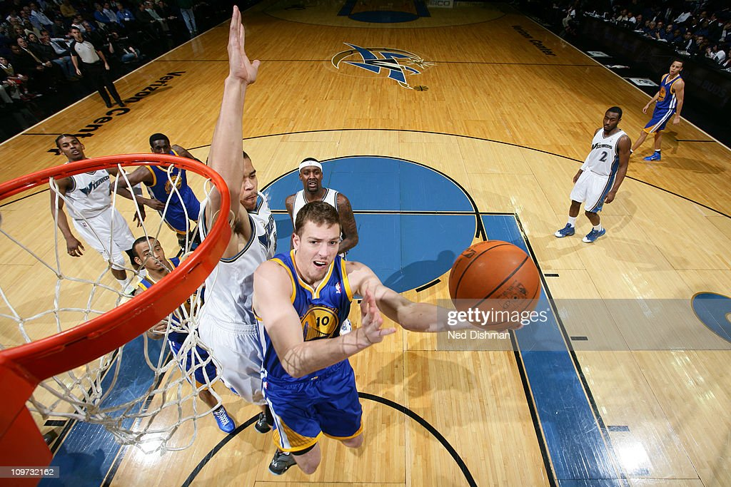 David Lee #10 of the Golden State Warriors shoots against <a gi-track='captionPersonalityLinkClicked' href=/galleries/search?phrase=JaVale+McGee&family=editorial&specificpeople=4195625 ng-click='$event.stopPropagation()'>JaVale McGee</a> #34 of the Washington Wizards at the Verizon Center on March 2, 2011 in Washington, DC.
