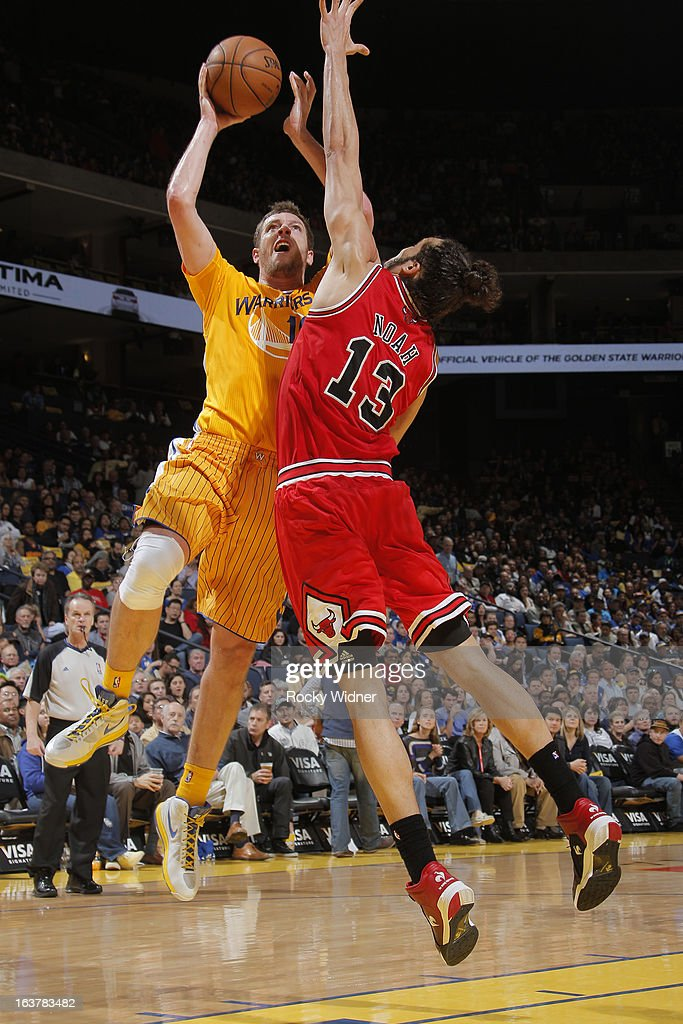 David Lee #10 of the Golden State Warriors shoots against Joakim Noah #13 of the Chicago Bulls on March 15, 2013 at Oracle Arena in Oakland, California.