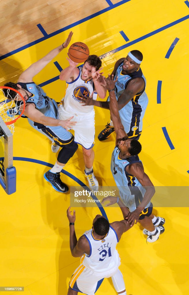 David Lee #10 of the Golden State Warriors shoots against <a gi-track='captionPersonalityLinkClicked' href=/galleries/search?phrase=Marc+Gasol&family=editorial&specificpeople=661205 ng-click='$event.stopPropagation()'>Marc Gasol</a> #33, <a gi-track='captionPersonalityLinkClicked' href=/galleries/search?phrase=Zach+Randolph&family=editorial&specificpeople=201595 ng-click='$event.stopPropagation()'>Zach Randolph</a> #50, and <a gi-track='captionPersonalityLinkClicked' href=/galleries/search?phrase=Tony+Allen+-+Basketball+Player&family=editorial&specificpeople=201665 ng-click='$event.stopPropagation()'>Tony Allen</a> #9 of the Memphis Grizzlies on January 9, 2013 at Oracle Arena in Oakland, California.