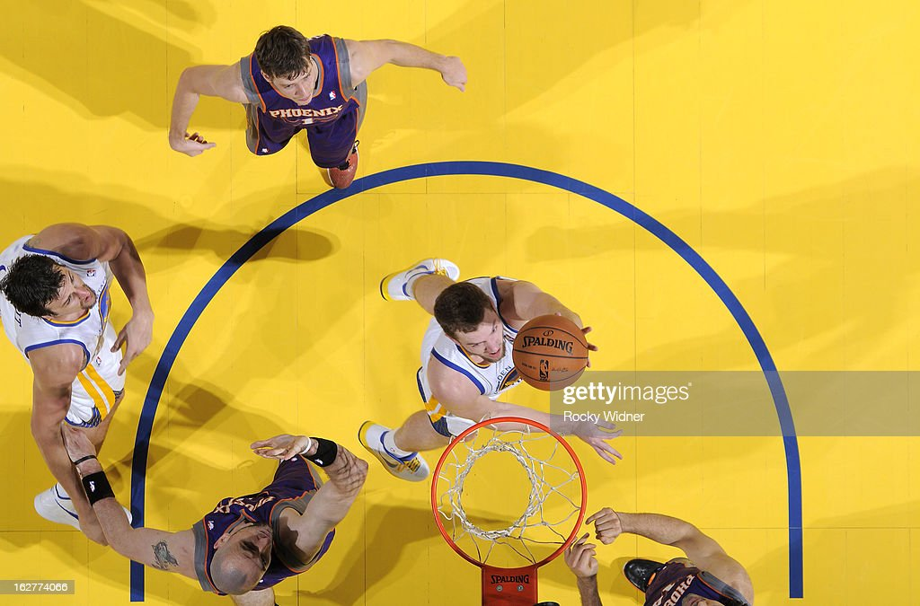 David Lee #10 of the Golden State Warriors shoots against <a gi-track='captionPersonalityLinkClicked' href=/galleries/search?phrase=Marcin+Gortat&family=editorial&specificpeople=589986 ng-click='$event.stopPropagation()'>Marcin Gortat</a> #4 of the Phoenix Suns on February 20, 2013 at Oracle Arena in Oakland, California.