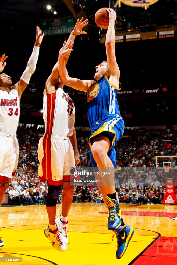 David Lee #10 of the Golden State Warriors shoots against <a gi-track='captionPersonalityLinkClicked' href=/galleries/search?phrase=Shane+Battier&family=editorial&specificpeople=201814 ng-click='$event.stopPropagation()'>Shane Battier</a> #31 and <a gi-track='captionPersonalityLinkClicked' href=/galleries/search?phrase=Ray+Allen&family=editorial&specificpeople=201511 ng-click='$event.stopPropagation()'>Ray Allen</a> #34 of the Miami Heat on December 12, 2012 at American Airlines Arena in Miami, Florida.