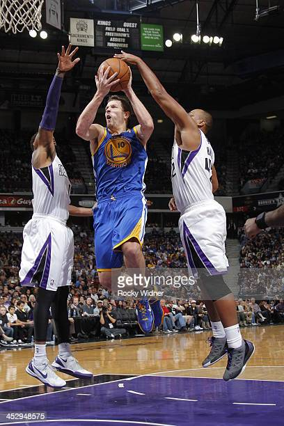 David Lee of the Golden State Warriors shoots the ball against Chuck Hayes of the Sacramento Kings at Sleep Train Arena on December 1 2013 in...