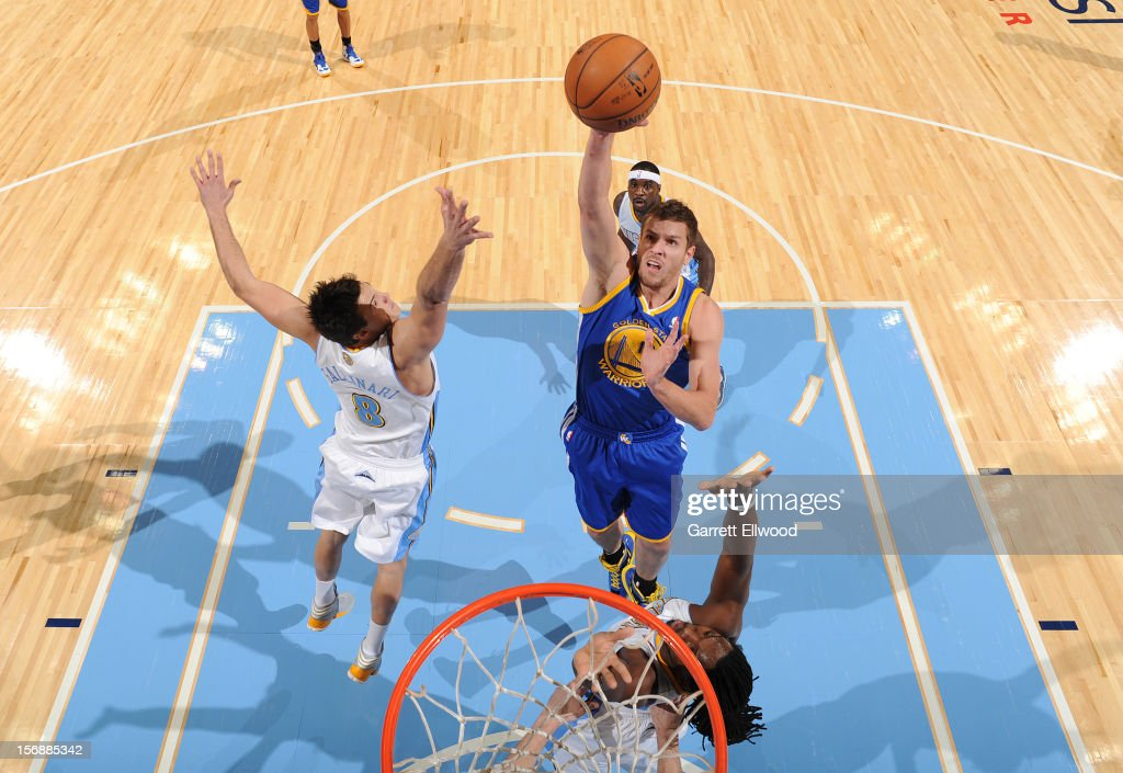 David Lee #10 of the Golden State Warriors shoots the ball against <a gi-track='captionPersonalityLinkClicked' href=/galleries/search?phrase=Danilo+Gallinari&family=editorial&specificpeople=4644476 ng-click='$event.stopPropagation()'>Danilo Gallinari</a> #8 and <a gi-track='captionPersonalityLinkClicked' href=/galleries/search?phrase=Kenneth+Faried&family=editorial&specificpeople=5765135 ng-click='$event.stopPropagation()'>Kenneth Faried</a> #35 of the Denver Nuggets on November 23, 2012 at the Pepsi Center in Denver, Colorado.