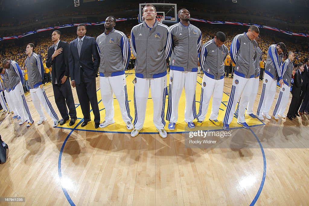 David Lee #10 of the Golden State Warriors stands with his teammates during the national anthem before facing the Denver Nuggets in Game Six of the Western Conference Quarterfinals during the 2013 NBA Playoffs on May 2, 2013 at Oracle Arena in Oakland, California.