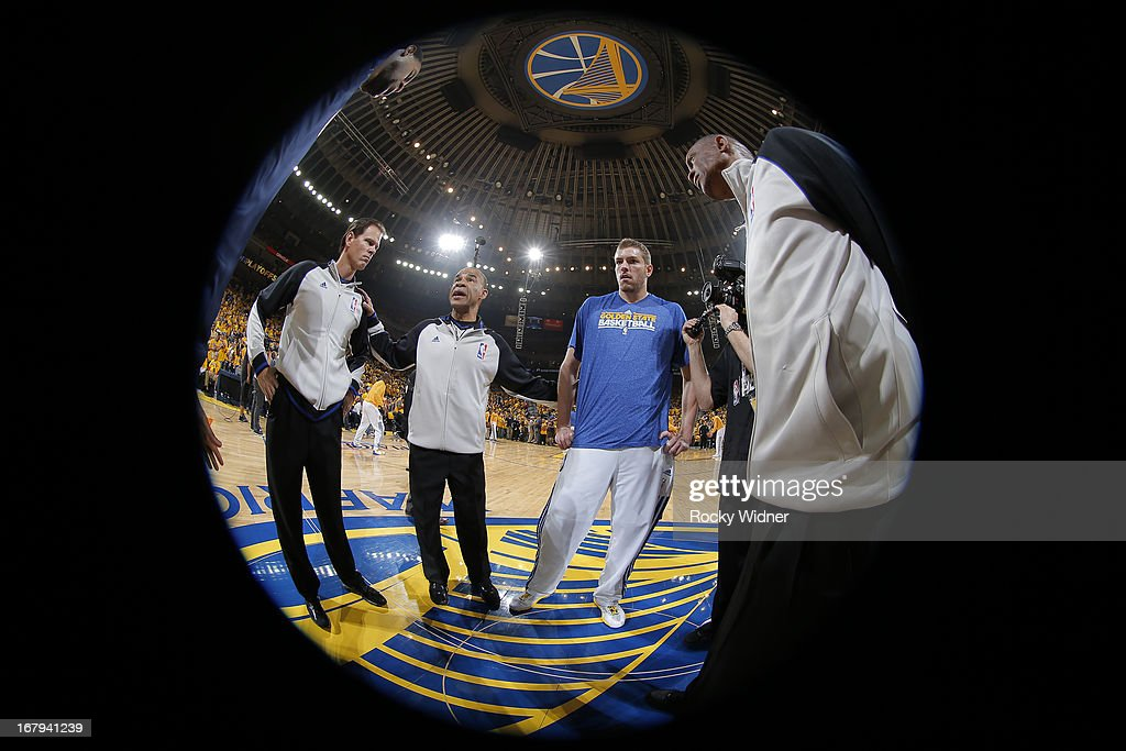 David Lee #10 of the Golden State Warriors stands with the referees at center court before facing the Denver Nuggets in Game Six of the Western Conference Quarterfinals during the 2013 NBA Playoffs on May 2, 2013 at Oracle Arena in Oakland, California.