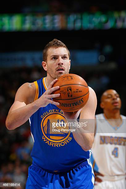 David Lee of the Golden State Warriors takes a free throw against the Denver Nuggets at Pepsi Center on March 13 2015 in Denver Colorado The Nuggets...
