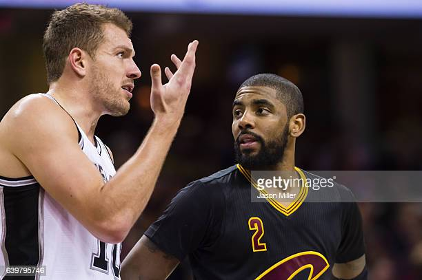 David Lee of the San Antonio Spurs talks to Kyrie Irving of the Cleveland Cavaliers on the court during the first half at Quicken Loans Arena on...