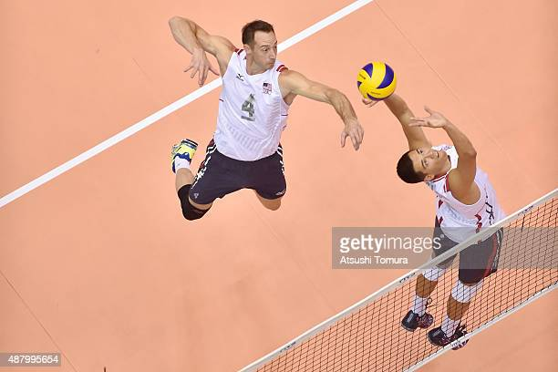 David Lee of the USA spikes in the match between Egypt and USA during the FIVB Men's Volleyball World Cup Japan 2015 at the Hiroshima Green Arena on...