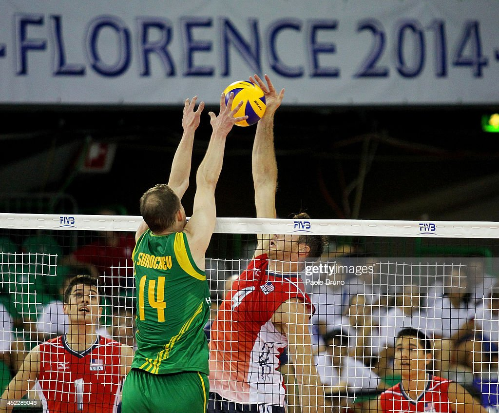 David Lee of United States spikes the ball as Grigory Sukochev #14 of Australia blocks during the FIVB World League Final Six match between United States and Australia at Mandela Forum on July 17, 2014 in Florence, Italy.