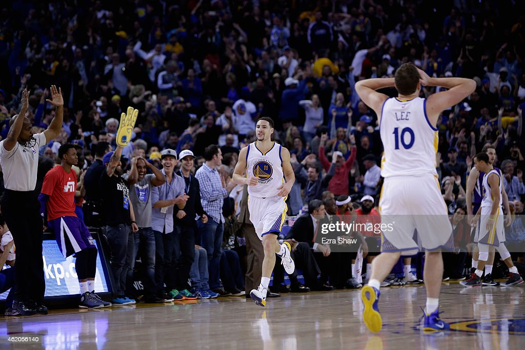 <a gi-track='captionPersonalityLinkClicked' href=/galleries/search?phrase=David+Lee+-+Basketball+Player&family=editorial&specificpeople=5503251 ng-click='$event.stopPropagation()'>David Lee</a> #10 reacts as <a gi-track='captionPersonalityLinkClicked' href=/galleries/search?phrase=Klay+Thompson&family=editorial&specificpeople=5132325 ng-click='$event.stopPropagation()'>Klay Thompson</a> #11 of the Golden State Warriors runs back downcourt after Thompson made a three-point basket in the third quarter of their game against the Sacramento Kings at ORACLE Arena on January 23, 2015 in Oakland, California. Thompson scored 37 points in the third quarter to set a NBA record.