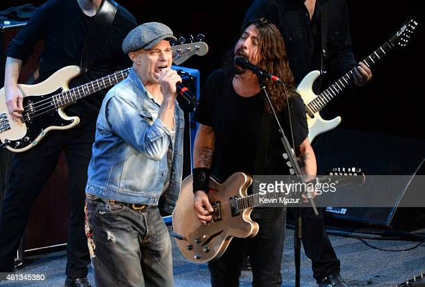 David Lee Roth and Dave Grohl perform onstage during Dave Grohl's birthday bash at The Forum on January 10 2015 in Inglewood California