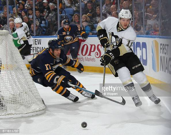 David Legwand of the Buffalo Sabres battles for the puck against Kevin Porter of the Pittsburgh Penguins during an NHL game on February 21 2016 at...