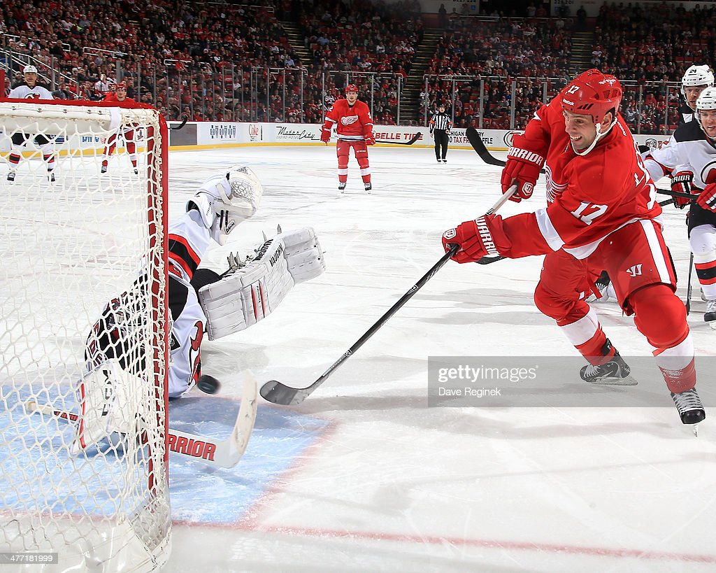 <a gi-track='captionPersonalityLinkClicked' href=/galleries/search?phrase=David+Legwand&family=editorial&specificpeople=202553 ng-click='$event.stopPropagation()'>David Legwand</a> #17 of the Detroit Red Wings beats a diving <a gi-track='captionPersonalityLinkClicked' href=/galleries/search?phrase=Cory+Schneider&family=editorial&specificpeople=696908 ng-click='$event.stopPropagation()'>Cory Schneider</a> #35 of the New Jersey Devils scoring his first goal since joining the team during an NHL game on March 7, 2014 at Joe Louis Arena in Detroit, Michigan.