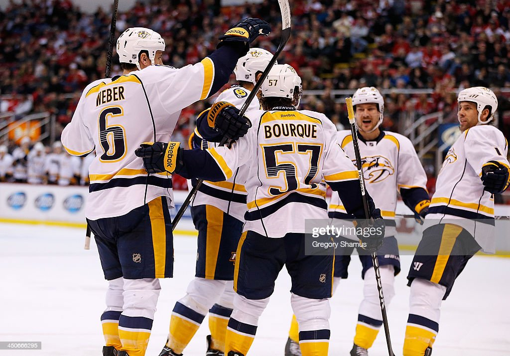 <a gi-track='captionPersonalityLinkClicked' href=/galleries/search?phrase=David+Legwand&family=editorial&specificpeople=202553 ng-click='$event.stopPropagation()'>David Legwand</a> #11 of the Nashville Predators celebrates his third-period goal with <a gi-track='captionPersonalityLinkClicked' href=/galleries/search?phrase=Gabriel+Bourque&family=editorial&specificpeople=5627917 ng-click='$event.stopPropagation()'>Gabriel Bourque</a> #57 and <a gi-track='captionPersonalityLinkClicked' href=/galleries/search?phrase=Shea+Weber&family=editorial&specificpeople=554412 ng-click='$event.stopPropagation()'>Shea Weber</a> #6 against the Detroit Red Wings at Joe Louis Arena on November 19, 2013 in Detroit, Michigan.