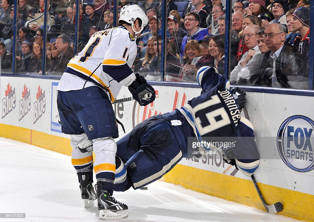 <a gi-track='captionPersonalityLinkClicked' href=/galleries/search?phrase=David+Legwand&family=editorial&specificpeople=202553 ng-click='$event.stopPropagation()'>David Legwand</a> #11 of the Nashville Predators cross checks <a gi-track='captionPersonalityLinkClicked' href=/galleries/search?phrase=Ryan+Johansen&family=editorial&specificpeople=6698841 ng-click='$event.stopPropagation()'>Ryan Johansen</a> #19 of the Columbus Blue Jackets during the third period on March 19, 2013 at Nationwide Arena in Columbus, Ohio. Legwand was charged with a cross checking minor penalty. Columbus defeated Nashville 4-3.