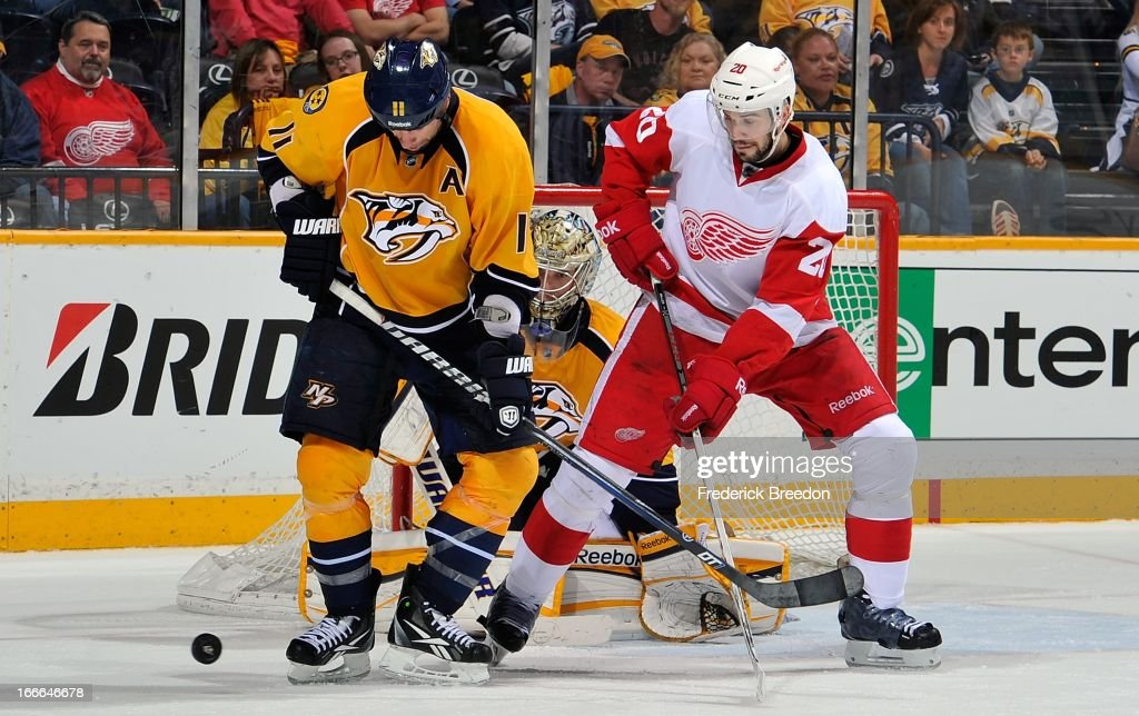 <a gi-track='captionPersonalityLinkClicked' href=/galleries/search?phrase=David+Legwand&family=editorial&specificpeople=202553 ng-click='$event.stopPropagation()'>David Legwand</a> #11 of the Nashville Predators fights Drew Miller #20 of the Detroit Red Wings for a lose puck at the Bridgestone Arena on April 14, 2013 in Nashville, Tennessee.