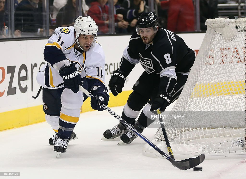 David Legwand #11 of the Nashville Predators is pursued by Drew Doughty #8 of the Los Angeles Kings for the puck in overtime at Staples Center on January 31, 2013 in Los Angeles, California. The Predators defeated the Kings 2-1 in a shootout.