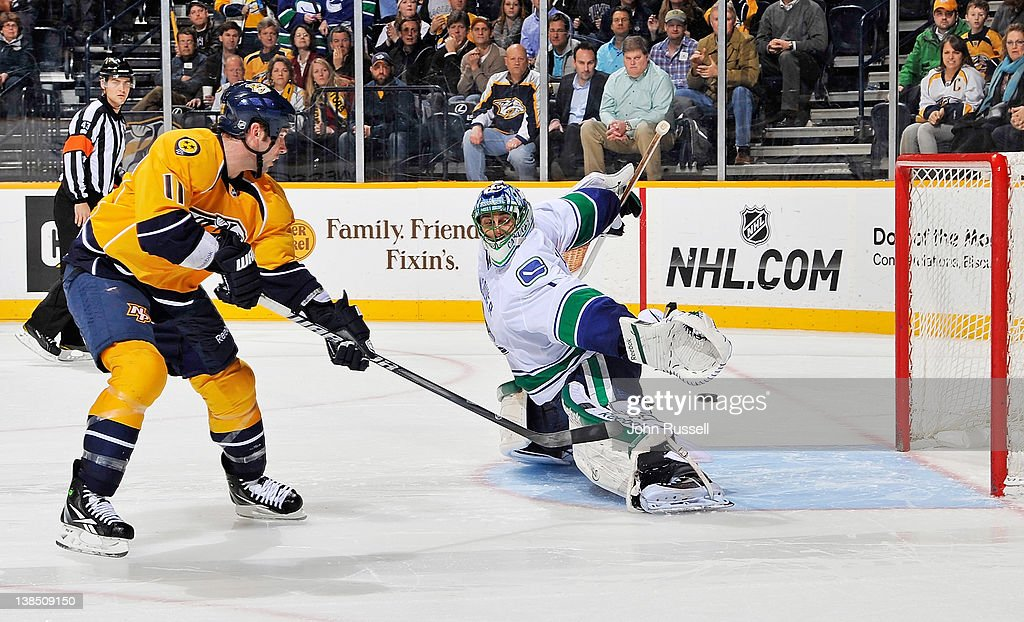 <a gi-track='captionPersonalityLinkClicked' href=/galleries/search?phrase=David+Legwand&family=editorial&specificpeople=202553 ng-click='$event.stopPropagation()'>David Legwand</a> #11 of the Nashville Predators puts the puck in the net in a shootout against <a gi-track='captionPersonalityLinkClicked' href=/galleries/search?phrase=Roberto+Luongo&family=editorial&specificpeople=202638 ng-click='$event.stopPropagation()'>Roberto Luongo</a> #1 of the Vancouver Canucks during an NHL game at the Bridgestone Arena on February 7, 2012 in Nashville, Tennessee.