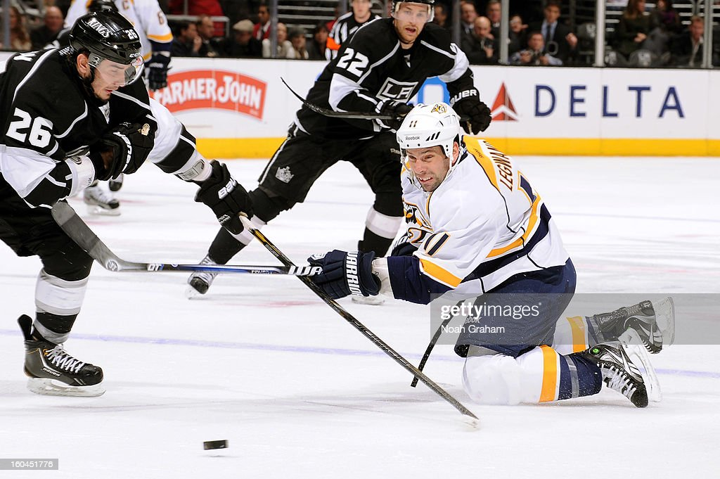 <a gi-track='captionPersonalityLinkClicked' href=/galleries/search?phrase=David+Legwand&family=editorial&specificpeople=202553 ng-click='$event.stopPropagation()'>David Legwand</a> #11 of the Nashville Predators reaches for the puck against the Los Angeles Kings at Staples Center on January 31, 2013 in Los Angeles, California.