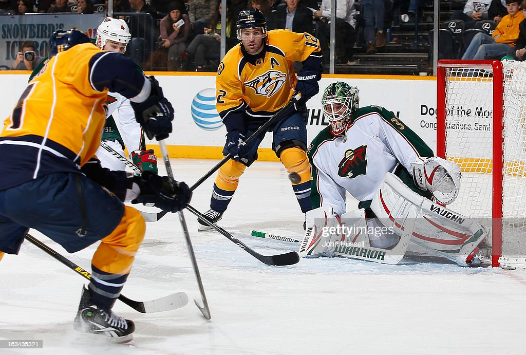 <a gi-track='captionPersonalityLinkClicked' href=/galleries/search?phrase=David+Legwand&family=editorial&specificpeople=202553 ng-click='$event.stopPropagation()'>David Legwand</a> #11 of the Nashville Predators scores on a shot against Niklas Backstrom #32 of the Minnesota Wild during an NHL game at the Bridgestone Arena on March 9, 2013 in Nashville, Tennessee.