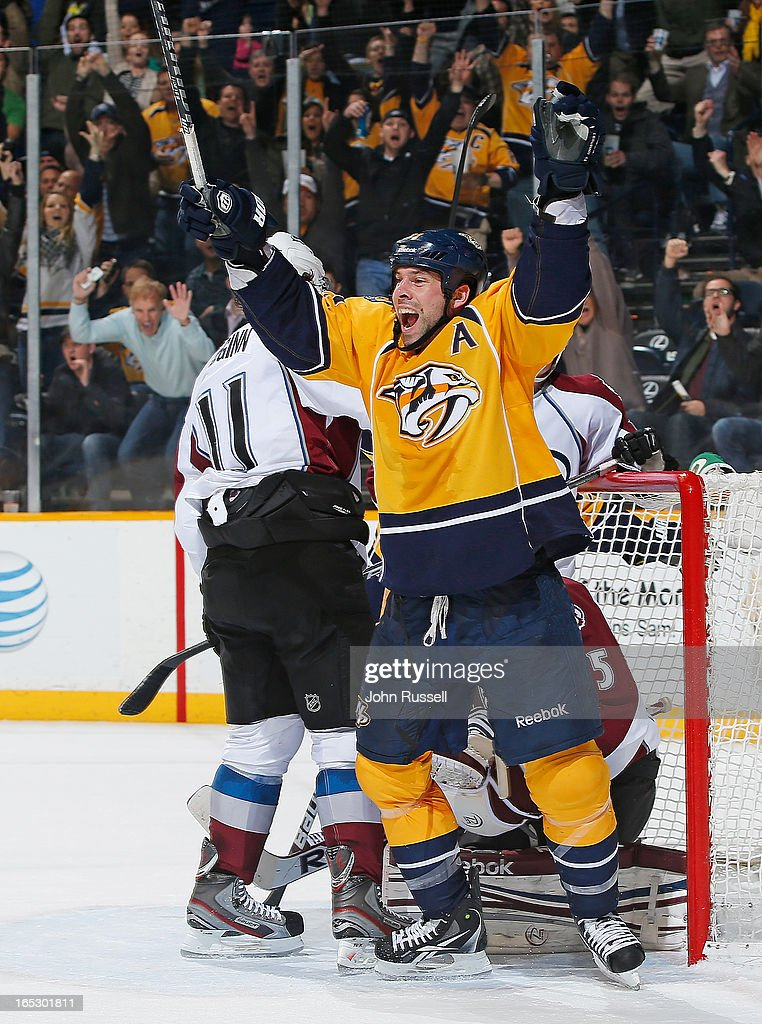 <a gi-track='captionPersonalityLinkClicked' href=/galleries/search?phrase=David+Legwand&family=editorial&specificpeople=202553 ng-click='$event.stopPropagation()'>David Legwand</a> #11 of the Nashville Predators scores the game winner against the Colorado Avalanche during an NHL game at the Bridgestone Arena on April 2, 2013 in Nashville, Tennessee.